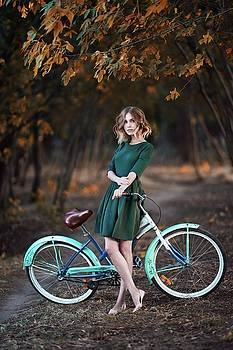 Girl and bicycle by Alexander Vinogradov