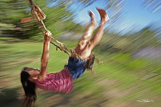 Girl on a swing by Tim Fitzharris