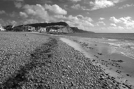 Girl on Sidmouth beach by Chris Day