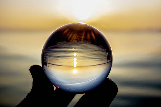Glass ball on the lake at sunrise by Sven Brogren