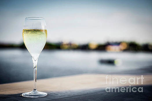 Glass Of Champagne At Modern Outdoor Bar At Sunset by Jacek Malipan