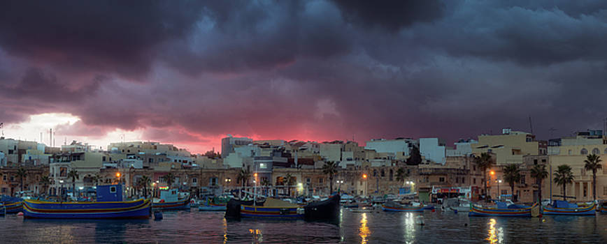 Gloomy sunset at fishing village Marsaxlokk, Malta by Sergey Ryzhkov