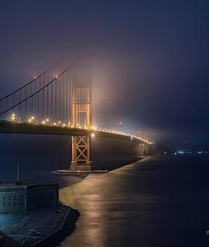 Golden Gate Bridge in summer night fog by Mark Chandler