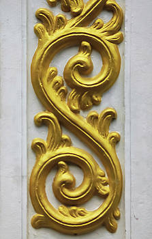 Golden Stucco Work On The Wall by Prasert Chiangsakul