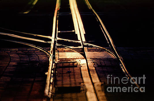 Golden Sunset Glow on Cable Car Tracks by Wernher Krutein