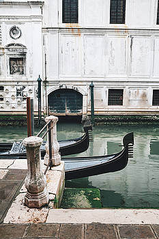 Gondolas on a canal in Venice, Italy by Ivan Bastien