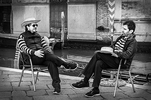 Gondoliers Relaxing in Venice by Barry O Carroll