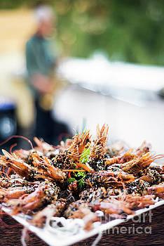 Gourmet Kampot Pepper Sauce Prawns In Modern Outdoor Bar by Jacek Malipan