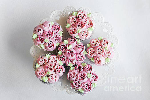 Gourmet Pink Decorated Cupcakes On Table by Jacek Malipan