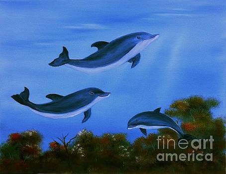Graceful Dolphins at play. by Cynthia Adams