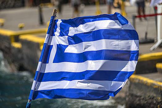 Eduardo Huelin - Greek flag in a Touristic ship in Santorini Greece