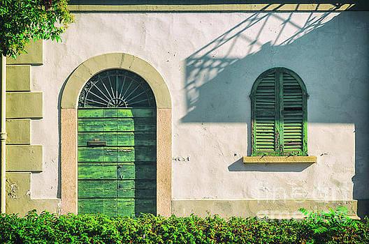 Green door and window by Silvia Ganora