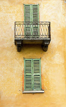 Green shuttered windows by Oscar Gutierrez
