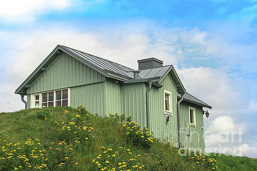 Green wooden House in Sweden by Amanda Mohler