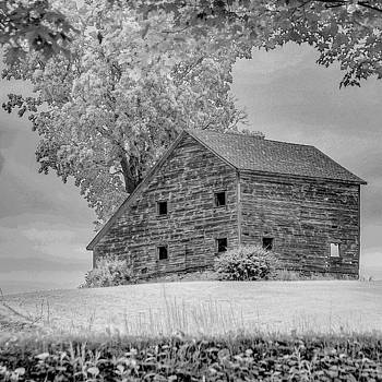 Grey barn on a grey day by Kendall McKernon