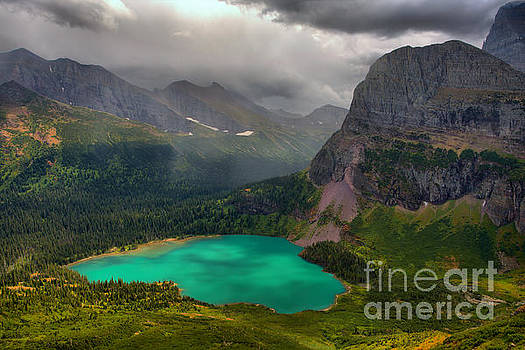 Grinnell Lake Shining Under The Storm by Adam Jewell