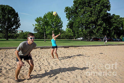 Herronstock Prints - Group of friends women and men - playing beach volleyball Zilker Park Sand Volleyball Courts