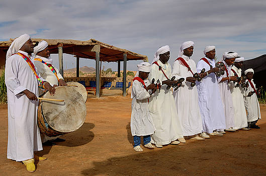 Reimar Gaertner - Group of Gnawa musicians in white robes dancing and playing krak