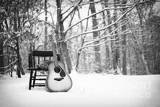 Guitar Leaning Against a Chair in the Snow - Black and White by Brycia James