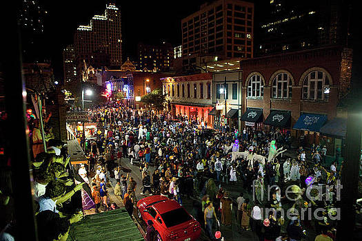 Herronstock Prints - Halloween draws tens of thousands to celebrate on Sixth Street