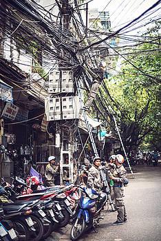 HANOI, VIETNAM, A technician is repairing by Eduardo Huelin