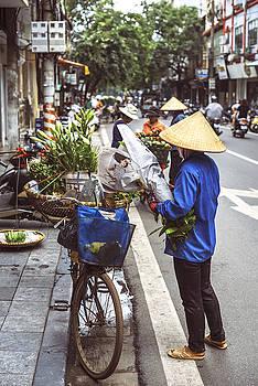 Hanoi, Vietnam -  Vietnamese street market lady sell by Eduardo Huelin