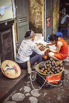 Hanoi, Vietnam -  Vietnamese street market seller, o by Eduardo Huelin