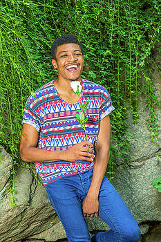 Alexander Image - Happy African American Man with white rose waiting for you at Ce