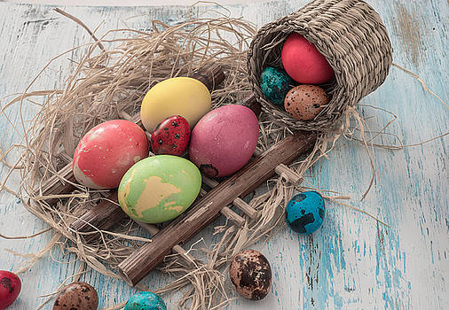 Happy Easter multi-colored eggs on wooden bacground by Julian Popov