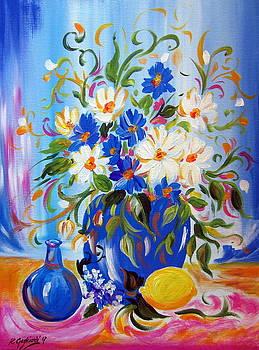 Happy Flowers with lemon in blue vase by Roberto Gagliardi