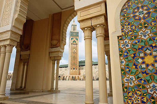 Reimar Gaertner - Hassan II Mosque minaret framed by a plaza arch and tilework in