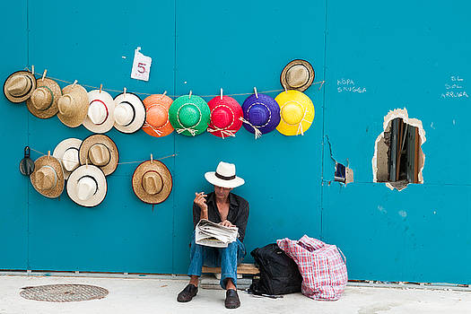 Hat seller with colorfull hats Barcelona Spain by Matthias Hauser