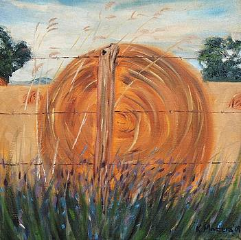 Hay Bale with wildflowers by Karen Masters