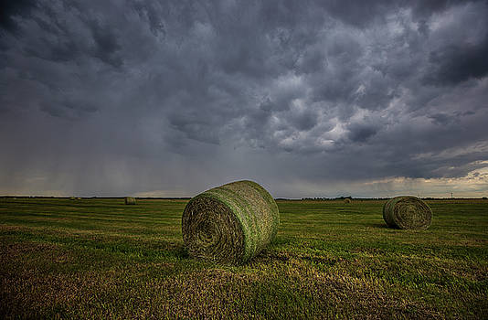 Hay Bales and Rain  by Aaron J Groen