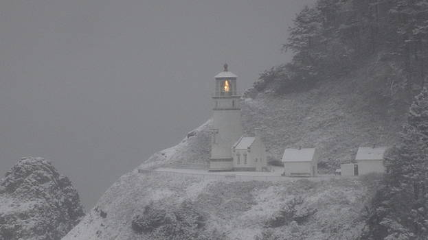 Heceta Lighthouse snowstorm by Kenny Henson