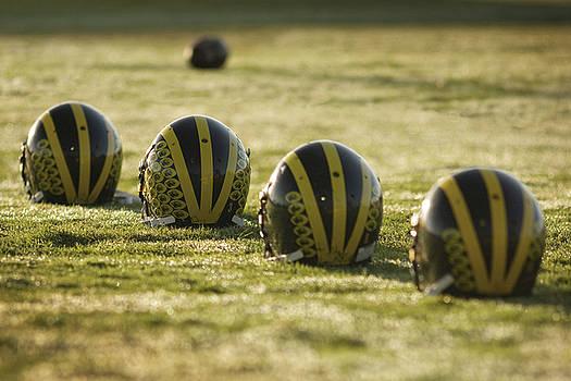 Helmets on Dew-Covered Field at Dawn by Michigan Helmet