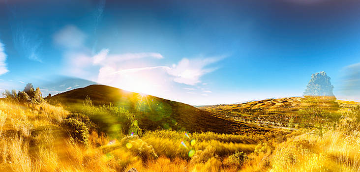 High Desert Autumn Sunset with Double Exposure, Warm Tones and Lens Flare by Brian Ball