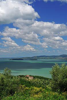 Reimar Gaertner - Hilltop view of sun dappled Lake Trasimeno in Umbria Italy