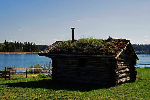Historic Trappers Log Cabin by Robert Braley