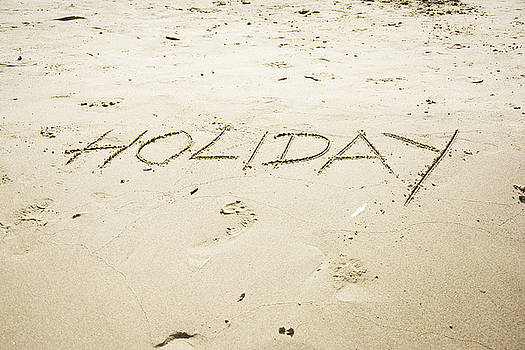 Newnow Photography By Vera Cepic - Holiday word written in sand