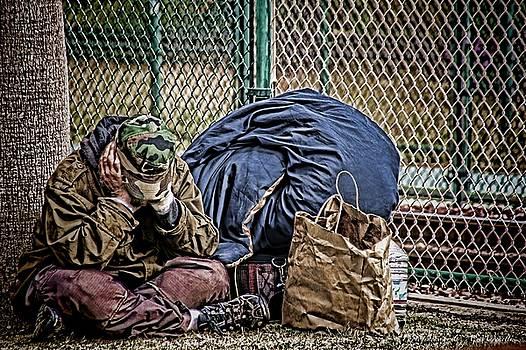 Homeless By The Rail by Carolyn Marchetti