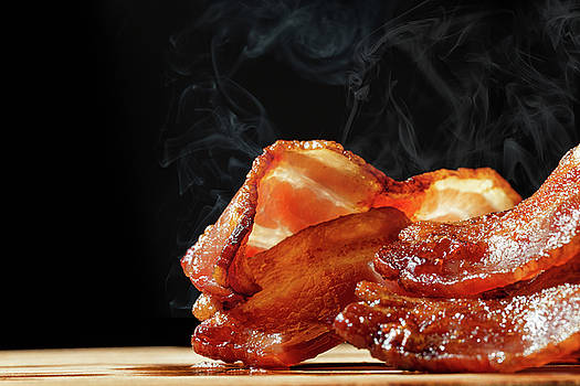 Hot Bacon With Steam Isolated on Black by Susan Schmitz