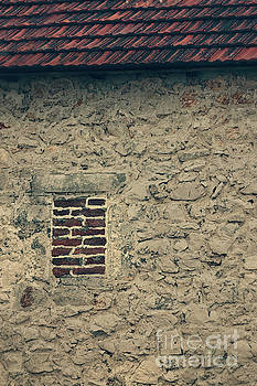 House with bricked window by Mythja Photography