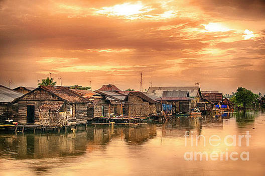 Huts on Water by Charuhas Images