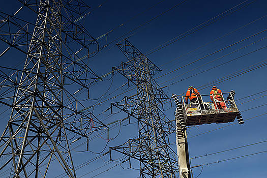 Reimar Gaertner - Hydro linemen on boom lift with old suspension insulators from h