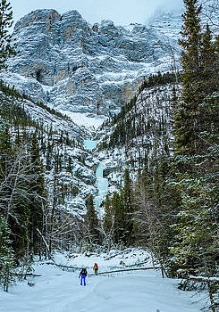 Ice climbers approaching Professor Falls rated WI4 in Banff Nati by Elijah Weber