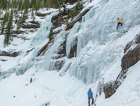 Ice Climbers on a route called Twin Falls in Hyalite Canyon Mont by Elijah Weber