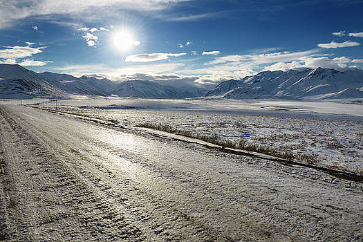 Reimar Gaertner - Ice covered dirt road Dalton Highway in the Brooks Range mountai