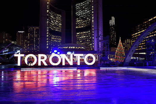 Reimar Gaertner - Ice rink at Nathan Phillips Square at night with City Hall and T
