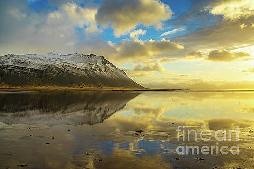 Iceland Golden Cloudscape and Snow Dusted Peaks by Mike Reid